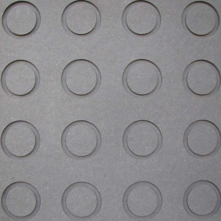 A grey board with 16 circular ring cut outs. Four across and four down.