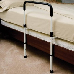 An upside down U shape adjacent to a bed. A stabilizing bar fits below the mattress and bed frame. The handle has a black pvc grip and black rubber feet.