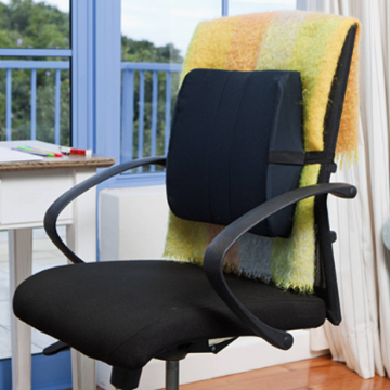 An office chair with a cushion support on the back of the chair to provide cushioning from lower back to below shoulder height.