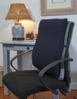 An office chair with a cushion support on the back of the chair to provide cushioning from lower back to above shoulder height.