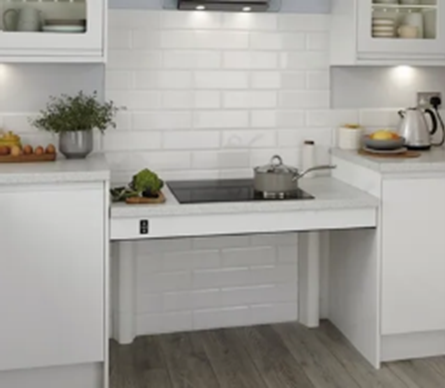 The kitchen is white in colour with a glass top hob.