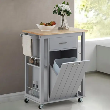 The image shows a grey mobile unit with a tip out bin, drawers, side shelves with a supporting bar, a towel rail, and a wooden cutting board top.